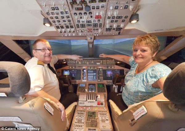14095579127610 cockpit4 Forced to give up his dream of being a pilot, this man builds a life sized Boeing simulator in his house!