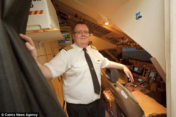14095579129808 cockpit10 Forced to give up his dream of being a pilot, this man builds a life sized Boeing simulator in his house!
